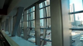 Travelator - moving walkway. View from windows on Dubai Marina, United Arab Emirates. Dubai is a city and emirate in the UAE. The emirate is located south of the Persian Gulf on the Arabian Peninsula