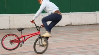 Trick cyclist. Girl on bicycle