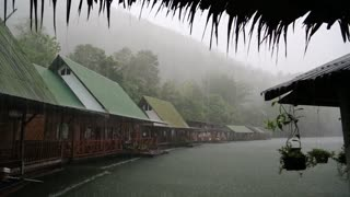 Tropical cloudburst on the Kwai river in Thailand. Raindrops fall from roof