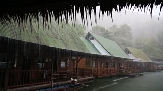 Tropical cloudburst on the Kwai river in Thailand
