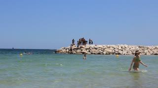 Tunisian boys on breakwater