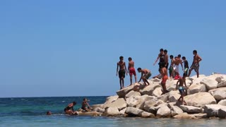 Tunisian boys on breakwater