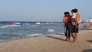 Tunisian family going on the beach