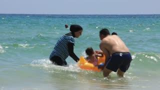 Tunisian family on the beach
