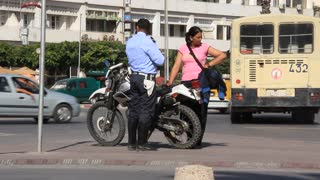 Tunisian policeman with motorcycle on the street