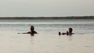 Two men bathe in Dead Sea, Israel