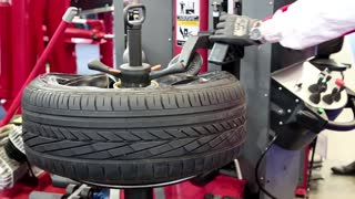 Tyre fitting. Worker remove the tire