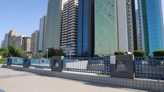 UAE, ABU DHABI, FEBRUARY 4, 2016: Building of Department of Planning and Economy, First Gulf Tower, Petroleum Exhibition and other towers at Corniche in Abu Dhabi - capital of the United Arab Emirates