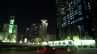 UAE, ABU DHABI, FEBRUARY 4, 2016: Evening road traffic near mosque in Abu Dhabi, United Arab Emirates. Abu Dhabi - capital and second most populous city in United Arab Emirates, after Dubai