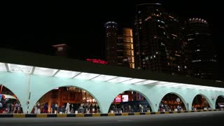 UAE, ABU DHABI, FEBRUARY 4, 2016: People on platform in main bus station in Abu Dhabi, capital and second most populous city in United Arab Emirates, after Dubai, and also capital of Abu Dhabi emirate