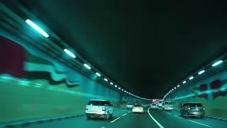 UAE, DUBAI, FEBRUARY 1, 2016: Driving through tunnel in Dubai, United Arab Emirates. Dubai is a city and emirate in United Arab Emirates, country located at the southeast end of Arabian Peninsula
