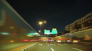 UAE, DUBAI, FEBRUARY 1, 2016: Driving through yellow tunnel in Dubai, United Arab Emirates. Dubai is a city and emirate in United Arab Emirates, country located at southeast end of Arabian Peninsula