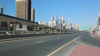 UAE, DUBAI, FEBRUARY 1, 2016: Dubai Marina traffic, United Arab Emirates. Dubai Marina - district in heart of what has become known as New Dubai. Dubai Marina - largest man-made marina in the world