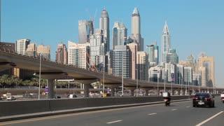 UAE, DUBAI, FEBRUARY 1, 2016: Dubai Marina traffic, United Arab Emirates. Dubai Marina - district in heart of what has become known as New Dubai. Dubai Marina -the largest man-made marina in the world
