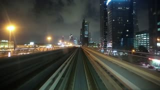 UAE, DUBAI, FEBRUARY 1, 2016: Dubai metro timelapse. Journey on driverless, fully automated metro rail network. The view through the front window. Dubai is a city and emirate in United Arab Emirates