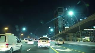 UAE, DUBAI, FEBRUARY 1, 2016: Dubai traffic at night, United Arab Emirates. Burj Khalifa megatall skyscraper. Dubai is a city and emirate in United Arab Emirates