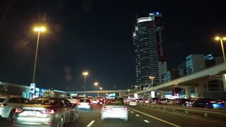 UAE, DUBAI, FEBRUARY 1, 2016: Dubai traffic at night, United Arab Emirates. Dubai Marina - district in heart of what has become known as New Dubai. Dubai is a city and emirate in United Arab Emirates