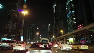UAE, DUBAI, FEBRUARY 1, 2016: Evening city traffic along Sheikh Zayed road in Dubai. Dubai is a city and emirate in United Arab Emirates