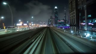 UAE, DUBAI, FEBRUARY 1, 2016: Journey on driverless, fully automated metro rail network in Dubai, UAE. The view through the front window. Dubai is a city and emirate in United Arab Emirates