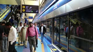 UAE, DUBAI, FEBRUARY 1, 2016: People inside Dubai metro station. Dubai Metro is a driverless, fully automated metro network. Dubai is a city and emirate in United Arab Emirates