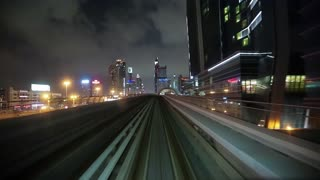 UAE, DUBAI, FEBRUARY 1, 2016: Train is approaching and enters into metro station, Dubai, United Arab Emirates. Dubai Metro is a driverless, fully automated metro network. The view through front window