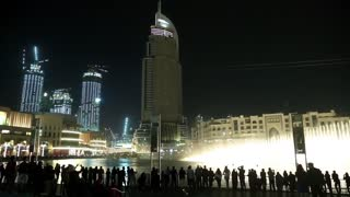 UAE, DUBAI, FEBRUARY 3, 2016: People near singing fountains near Burj Khalifa megatall skyscraper in Dubai, United Arab Emirates. The Dubai Fountain -  world largest choreographed fountain system set