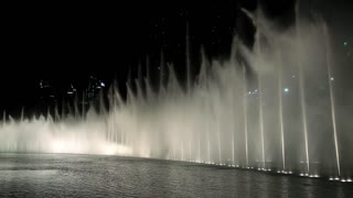 UAE, DUBAI, FEBRUARY 3, 2016: Singing fountains near Burj Khalifa megatall skyscraper in Dubai, United Arab Emirates. The Dubai Fountain -  world largest choreographed fountain system set