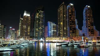UAE, DUBAI, FEBRUARY 3, 2016: UHD 4K Dubai Marina night zoom time lapse, United Arab Emirates. Dubai Marina - the largest man-made marina in the world