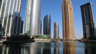 UAE, DUBAI, FEBRUARY 5, 2016: Almas Tower supertall skyscraper and Jumeirah Lakes Towers, Dubai multi commodities centre, United Arab Emirates. Dubai is a city and emirate in UAE. JLT, DMCC