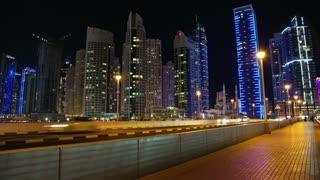 UAE, DUBAI, FEBRUARY 5, 2016: Dubai Marina night time lapse, United Arab Emirates. Dubai Marina - the largest man-made marina in the world