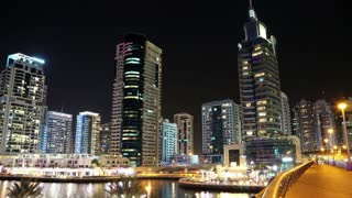 UAE, DUBAI, FEBRUARY 5, 2016: Dubai Marina night time lapse, United Arab Emirates. Dubai Marina - the largest man-made marina in the world