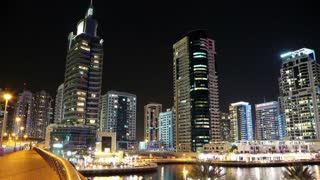 UAE, DUBAI, FEBRUARY 5, 2016: Dubai Marina night zoom in time lapse, United Arab Emirates. Dubai Marina - the largest man-made marina in the world