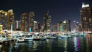 UAE, DUBAI, JANUARY 31, 2016: 4K Dubai Marina night time lapse, United Arab Emirates. Dubai Marina - the largest man-made marina in the world