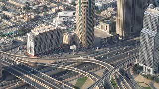 UAE, DUBAI, JANUARY 31, 2016: Dubai downtown traffic, United Arab Emirates. View on crossroads and Sheikh Zayed road from the 124th floor of Burj Khalifa megatall skyscraper in Dubai, UAE
