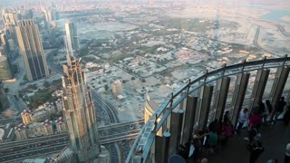 UAE, DUBAI, JANUARY 31, 2016: People on observation deck At the Top on 124 floor in Burj Khalifa skyscraper in Dubai. View from glass window of observation deck on 125 floor, 456 meters above ground