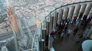 UAE, DUBAI, JANUARY 31, 2016: People on observation deck At the Top on 124 floor in Burj Khalifa skyscraper. View from glass window of observation deck on 125 floor, 456 meters above the ground