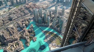UAE, DUBAI, JANUARY 31, 2016: Top view on Burj Khalifa Lake and Address hotel from 124th floor of Burj Khalifa skyscraper. Burj Khalifa - highest megatall skyscraper in the world, United Arab Emirates