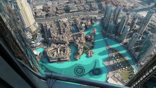 UAE, DUBAI, JANUARY 31, 2016: Top view on Burj Khalifa Lake and Address hotel from glass window on 124th floor of Burj Khalifa skyscraper. Burj Khalifa - highest megatall skyscraper in the world, UAE