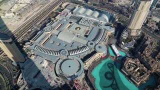 UAE, DUBAI, JANUARY 31, 2016: Top view on Dubai Mall and Burj Khalifa Lake from 124th floor of Burj Khalifa megatall skyscraper. Burj Khalifa - highest skyscraper in the world, UAE