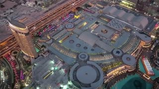 UAE, DUBAI, JANUARY 31, 2016: Top view on Dubai Mall and Burj Khalifa Lake from 124th floor of Burj Khalifa skyscraper. Burj Khalifa - highest megatall skyscraper in the world, UAE