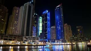 UHD 4K Dubai Marina night time lapse, United Arab Emirates. Dubai Marina - largest man-made marina in world. Dubai Marina is a canal city, carved along a 3 km stretch of Persian Gulf shoreline