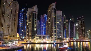 UHD 4K Dubai Marina night time lapse, United Arab Emirates. Dubai Marina - the largest man-made marina in the world. Dubai Marina is a canal city, carved along a 3 km stretch of Persian Gulf shoreline