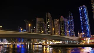 UHD 4K Dubai Marina night time lapse, United Arab Emirates. Dubai Marina - the largest man-made marina in the world. Dubai Marina is a canal city, carved along a 3 km stretch of Persian Gulf shoreline