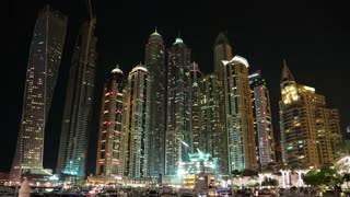 UHD 4K Dubai Marina night zoom in time lapse, United Arab Emirates. Dubai Marina - the largest man-made marina in the world, is a canal city, carved along a 3 km stretch of Persian Gulf shoreline