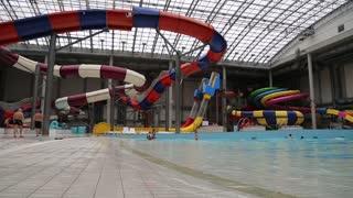 UKRAINE, BROVARY, NOVEMBER 25, 2013: People swim on the waves in blue pool inside big aquapark.