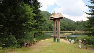 UKRAINE, CARPATHIANS, AUGUST 10, 2014: People at lake Synevyr in Carpathian Mountains, Ukraine