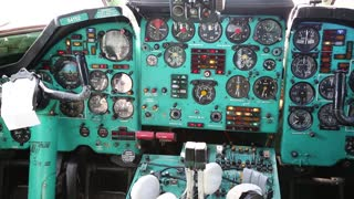 UKRAINE, KIEV, AUGUST 10, 2016: Inside educational training aircraft Tu-134UBL Combat Trainer. Old aircraft cabin. Aircraft instruments panel, interior of old airplane since the Soviet Union