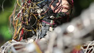 UKRAINE, KIEV, AUGUST 17, 2016: Woman face of sculpture, made of electric wires and electronic devices