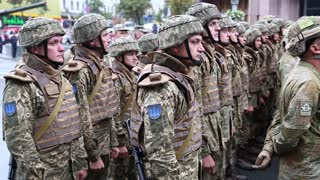 UKRAINE, KIEV, AUGUST 24, 2016: Soldiers in green uniform at military parade in Kiev, dedicated to 25th anniversary of Ukraines independence. Servicemen at military parade. Video with sound