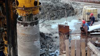 UKRAINE, KIEV, AUGUST 5, 2013: Builders on a construction site. Drilling wells for bored piles